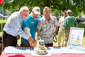 <em>Senator Patrick Leahy and Steve Stettler, producing artistic director of the Weston Playhouse Theatre Company, help Lyman cut the birthday cake.</em>