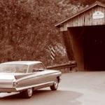 A 1962 Cadillac crosses the Gorham Bridge in Pittsford, Vt.
