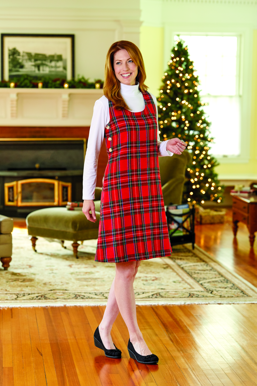 woman modeling Red Tartan Plaid Jumper in christmas living room scene
