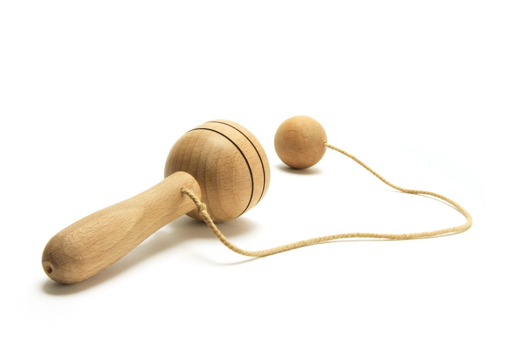 A wooden cup and ball inspired by the Colonial Toy.